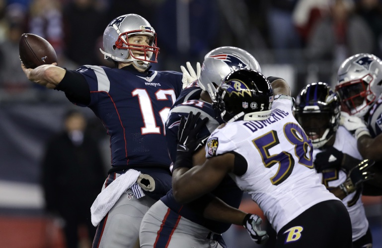 New England Patriots quarterback Tom Brady (12) throws a touchdown pass to Chris Hogan under pressure from Baltimore Ravens linebacker Elvis Dumervil (58) during the fourth quarter of an NFL football game, Monday, Dec. 12, 2016, in Foxborough, Mass. (AP Photo/Charles Krupa)
