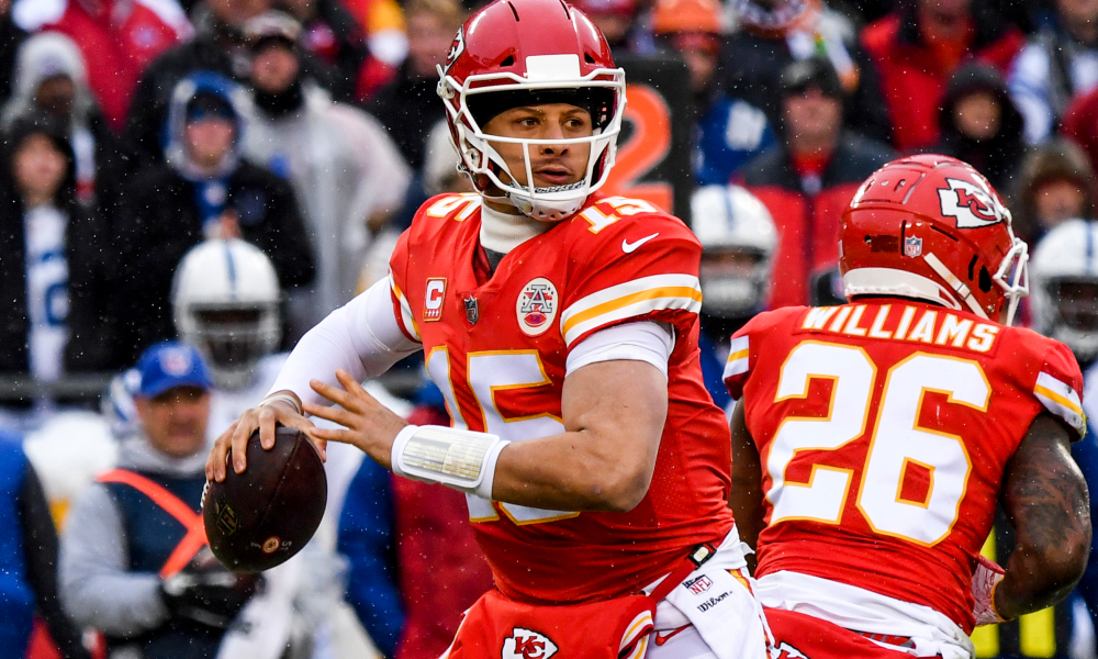 KANSAS CITY, MO - JANUARY 12: Patrick Mahomes #15 of the Kansas City Chiefs begins to throw a pass against the Indianapolis Colts during the first quarter of the AFC Divisional Round playoff game at Arrowhead Stadium on January 12, 2019 in Kansas City, Missouri. (Photo by Peter Aiken/Getty Images)