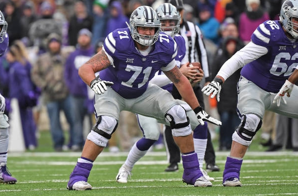 MANHATTAN, KS - NOVEMBER 17:  Offensive lineman Dalton Risner #71 of the Kansas State Wildcats gets set to make a block during the first half against the Texas Tech Red Raiders at Bill Snyder Family Football Stadium on November 17, 2018 in Manhattan, Kansas. (Photo by Peter G. Aiken/Getty Images)