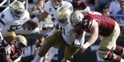 Notre Dame's Kurt Hinish (41) and Boston College's Ben Petrula (64) battle for a loose ball during the first half of an NCAA college football game in Boston, Saturday, Sept. 16, 2017. (AP Photo/Michael Dwyer)